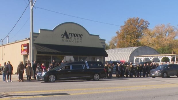 A crowd of more than 100 customers, friends and family gathered outside Arnone Cafe and Bakery to bid Salvatore Arnone final farewell Wednesday.