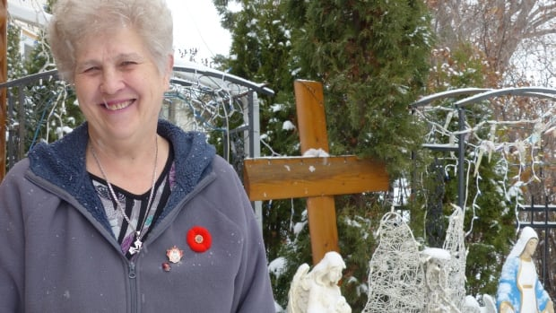 Shirley Oleskiw stands in her front yard, which she has named Mary's Garden. Throughout the year, Oleskiw and her family decorate the space to go with each Christian holiday and season of the year.