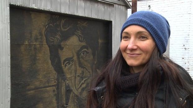 Deborah Teman's garage door no longer gets vandalized now that it features a portrait of Leonard Cohen.