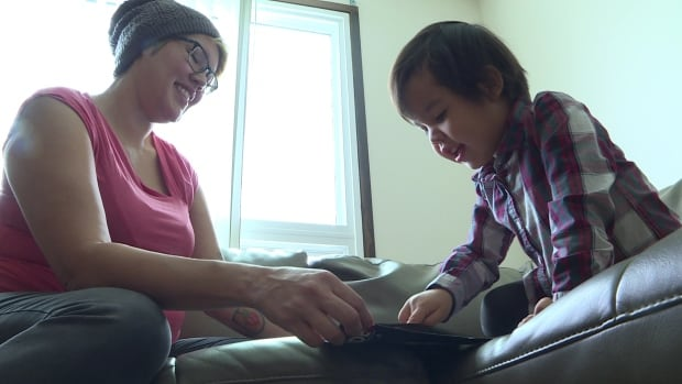 Cheyenna Sapp plays with her youngest daughter, Jae, at their new home in Saskatoon. The family moved from North Battleford in October 2017.
