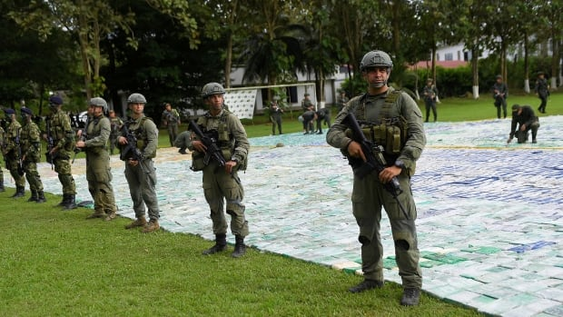 Colombian police and soldiers guard 11 tonnes of seized cocaine in Apartado, Colombia Nov. 8.