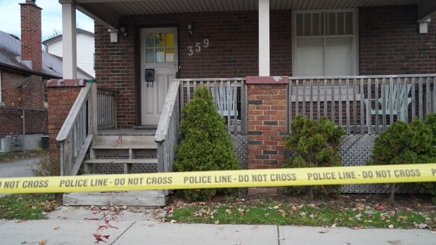 Crime tape surrounds a home at 359 Springbank Drive where a shooting in London occurred Wednesday night. Two people were taken to hospital.