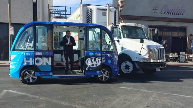 This photo by KVVU reporter Kathleen Jacob shows a driverless shuttle bus after it collided with a big rig in Las Vegas Wednesday, Nov. 8, 2017, less than two hours after the automated ride service was launched. Police say no injuries were reported.