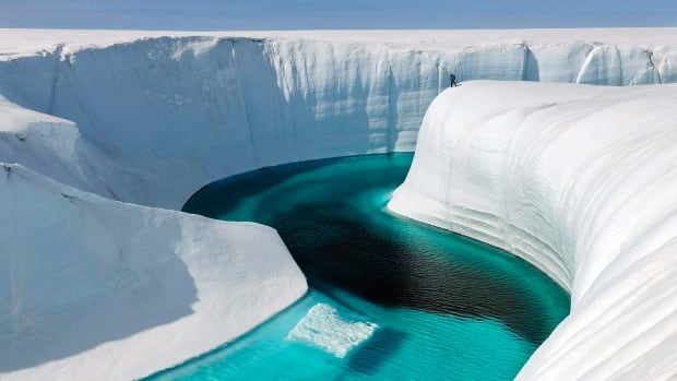 This 2009 photo released by Extreme Ice Survey shows Birthday Canyon in Greenland during the filming of Chasing Ice.' New findings about the melting of a western Canadian ice sheet at the end of the ice age may offer a preview of what's in store for Greenland's ice sheet as it melts from human-caused climate change.