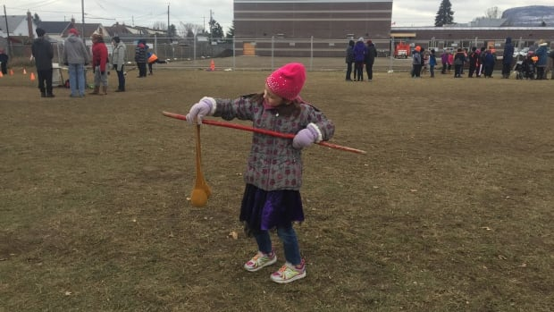 Students play traditional Indigenous games for Treaties Recognition Week in Thunder Bay, Ont. Here, a young girl tries double ball.