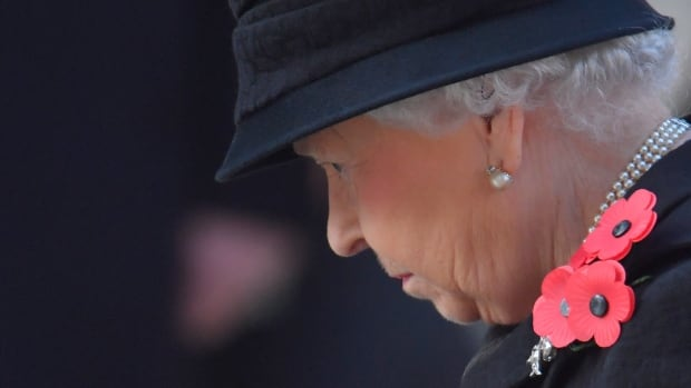 Queen Elizabeth watched the Remembrance Sunday ceremony from a nearby balcony as her eldest son and heir, Prince Charles, laid a wreath that she usually lays herself. It is a departure from tradition that signals a transition unfolding in the House of Windsor, but royal watchers say the Queen is still very much in control.
