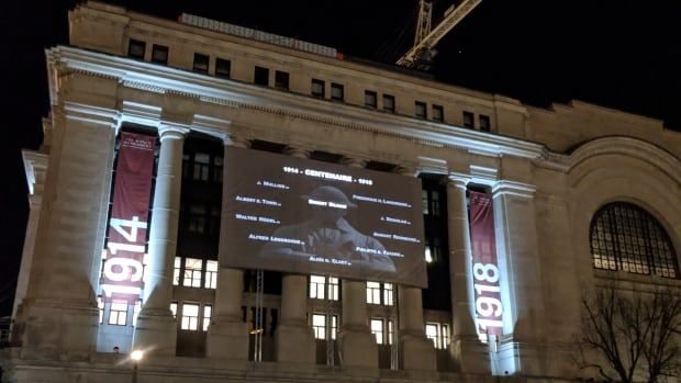 The names of fallen soldiers and other military personnel from the First World War are projected on the side of the Government Conference Centre in Ottawa on Wednesday, Nov. 8, 2017.