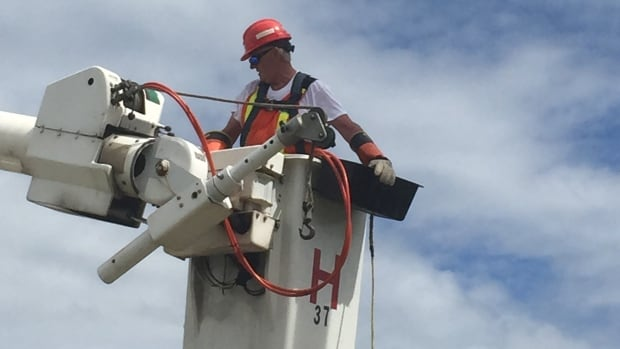 Even though Gilbert Johnson retired from Nova Scotia Power in 2000, he still puts his skills to work in areas hit hard by storms.