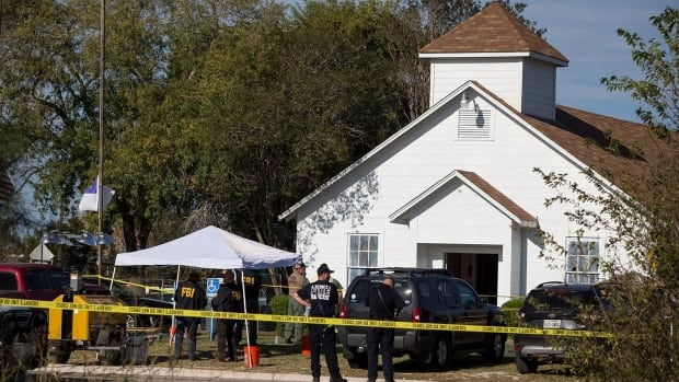 Law enforcement officials are shown working the scene the day of the shooting at the First Baptist Church, which will reportedly be demolished.