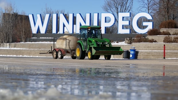 Crews at The Forks in Winnipeg work on Nov. 9 to put the first layer of ice down for the skating rink by the Scotiabank Stage.