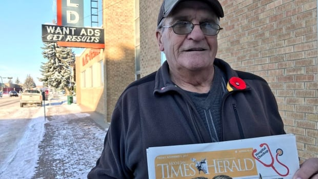 Wayne Coats holds the Nov. 9 edition of the Moose Jaw Times-Herald outside the paper's office Thursday.