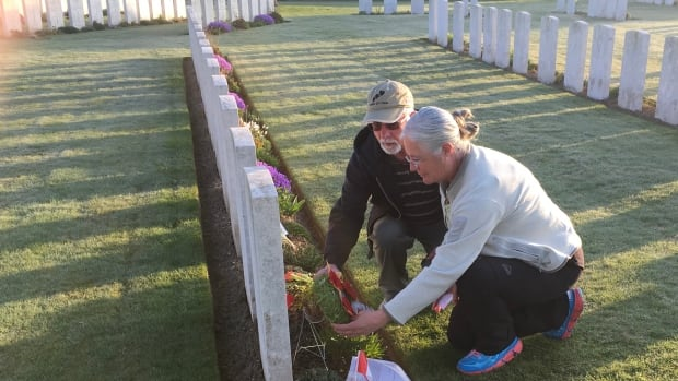 Rod and Helen Dewell at the gravesite of Yukoner Herbert Lawless in the Cabaret-Rouge British Cemetery near Vimy Ridge in France.