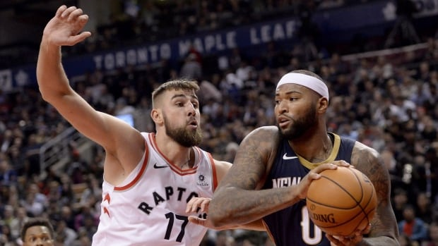 Toronto centre Jonas Valanciunas defends New Orleans' DeMarcus Cousins during the Raptors' 122-118 victory over the Pelicans on Thursday.