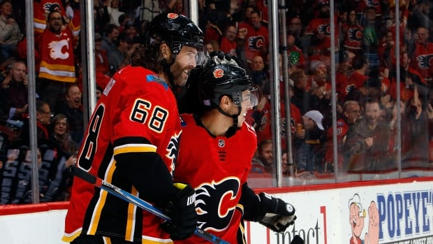 Jaromir Jagr, left, and Johnny Gaudreau, right, of the Flames celebrate a goal during the Calgary's 6-3 win over the Detroit Red Wings on Thursday.