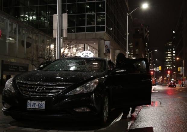 Sid Gebara gets into his taxi cab
