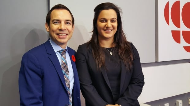 """Suelana Taha, right, seen here with hospital CEO Alex Munter, is CHEO's """"newcomer navigator,"""" helping patients and families new to Canada get around the hospital."""