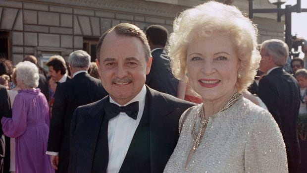 Magnum P.I. co-star John Hillerman, seen at the 1985 Emmy Awards with Betty White, has died at the age of 84.