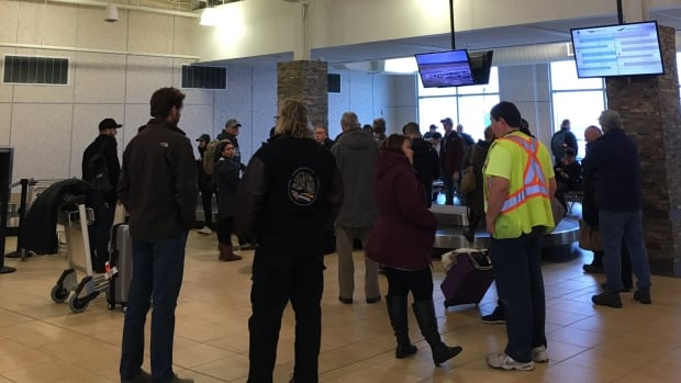 Passengers gather at the airport in Goose Bay, awaiting the first flights in or out in nearly three days.