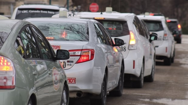 Hundreds of taxi drivers protested outside the Manitoba Legislative Building on Friday over Bill 30. The Local Vehicles for Hire Act will pave the way for ride-hailing programs like Uber.