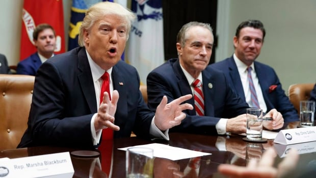 President Donald Trump, accompanied by Rep. Chris Collins, R-N.Y., (centre) speaks in the Roosevelt Room of the White House in Washington in February. Collins dropped a remark this week that illustrated how NAFTA is not the No. 1 economic priority in Washington these days, that issue is tax cuts.