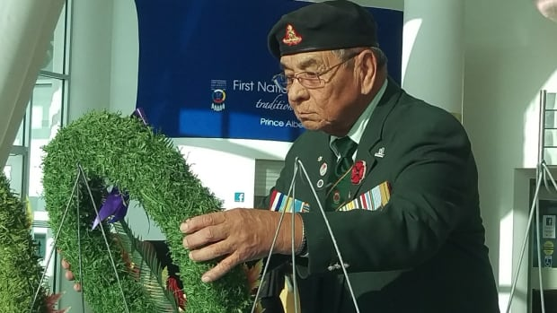 Elder and veteran Tony Cote lays the wreath in honour of Korean War veterans at the First Nations University of Canada Remembrance Day service on Thursday. Cote served in the Korean War with the 81st Field Regiment with the Canadian Artillery. His unit was shipped off to Korea in March 1953.