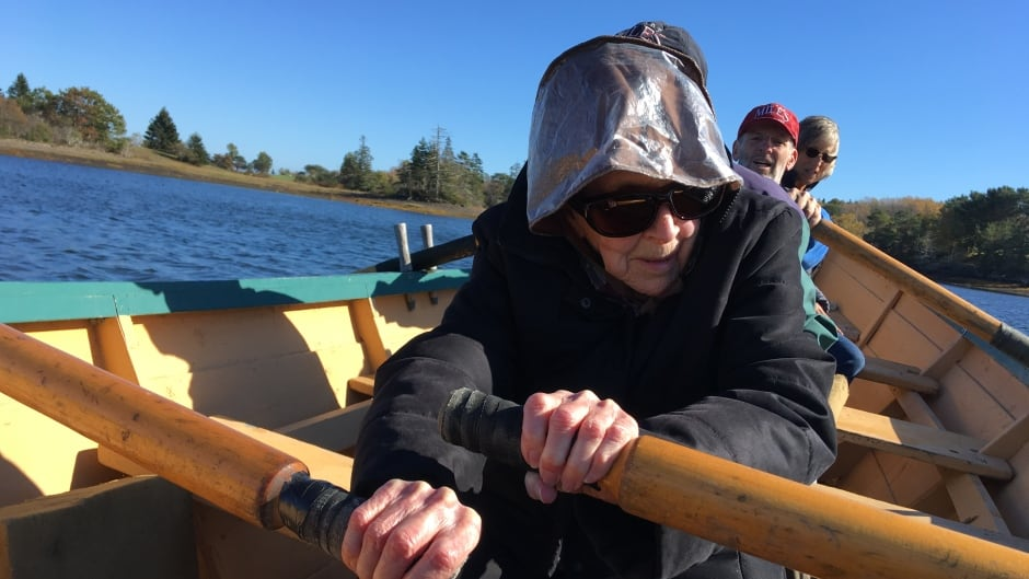 Margaret Meister enjoying a dory ride on her 102nd birthday. She took up painting the landscapes of her home in Lunenburg at 99. 'I always was a daredevil.'