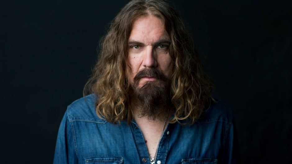 Former Junkhouse frontman Tom Wilson now plays with Blackie and the Rodeo Kings, and LeE HARVeY OsMOND