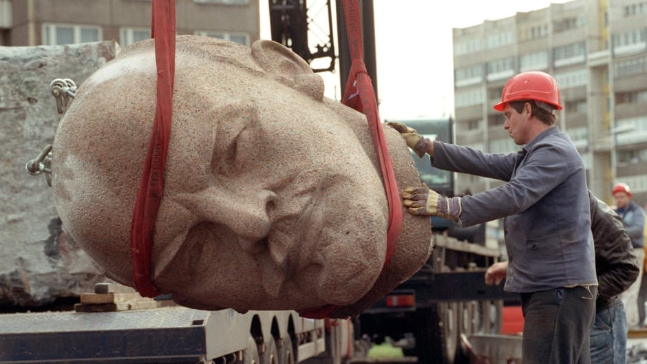 A photo dated November 13, 1991, shows a worker removing the head of a statue representing late Soviet leader Vladimir Ilyich Lenin during its demolition on the Leninplatz in Berlin. The 19-meter-tall statue of the Russian revolutionary was erected in 1970, shortly before the 100th anniversary of Lenin's birth.