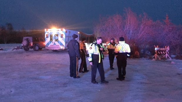 Emergency responders at the entrance for the Dettah ice road. They were responding to the report of a canoeist who had fallen into the water late Friday afternoon.