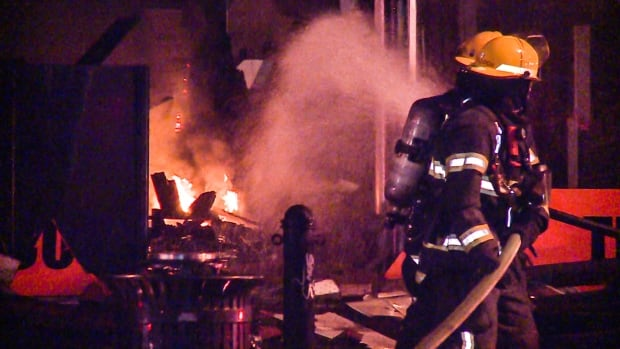 Firefighters put out a rogue blaze at a tile store, which made up a part of the burning building.