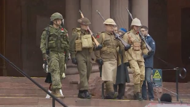 Soldiers arrive for the Remembrance Day ceremony at the Old City Hall Cenotaph.