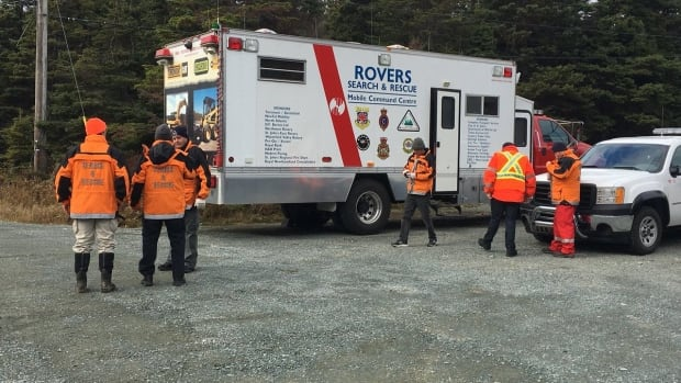 Members of the Rovers Search and Rescue team on O'Brien's Farm Road, off Mt. Scio Road in St. John's, Saturday afternoon.