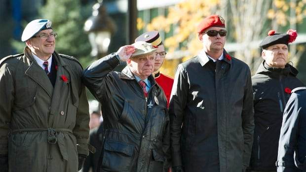 Veterans salute during a Remembrance Day ceremony in Montreal, Saturday, November 11, 2017.