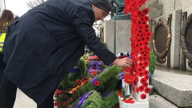 A man lays a wreath at the National War Memorial in St. John's as part of the Remembrance Day ceremony on Saturday.