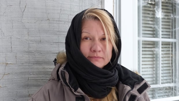 Regina resident Pauline Kinequon stands in front of her house on Rae Street. She says she witnessed her next-door neighbour being shot on Friday afternoon.