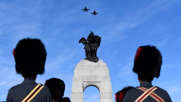 Royal Canadian Air Force CF-18 Hornets fly over the National War Memorial during the National Remembrance Day Ceremony in Ottawa on Saturday, Nov. 11, 2017.