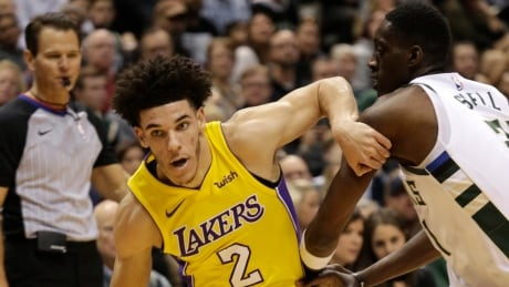 Lonzo Ball becomes youngest NBA player to record triple-double