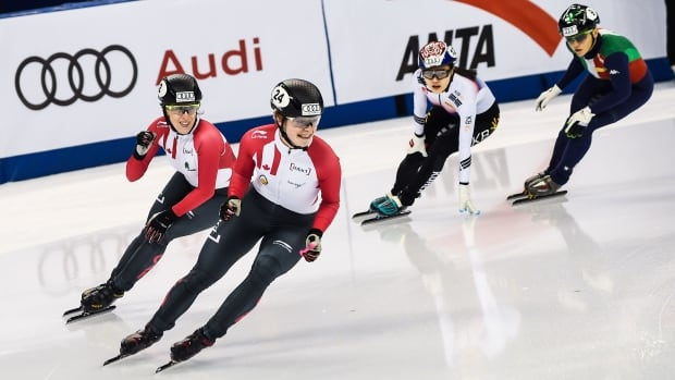 Canadians Kim Boutin, front, and Marianne St-Gelais, left, celebrate winning gold and silver, respectively, in the women's 1000m final at the ISU World Cup Short Track in Shanghai on Sunday.