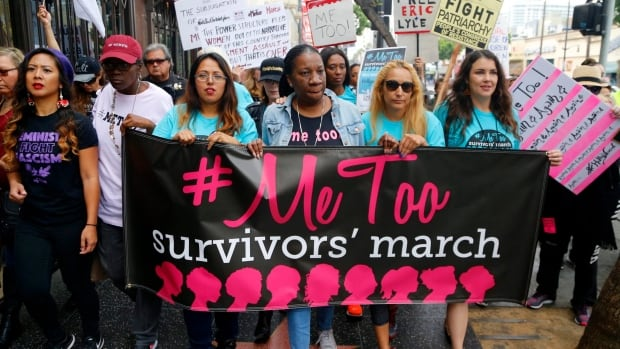 Participants march against sexual assault and harassment at the #MeToo march in Los Angeles on November 12, 2017.