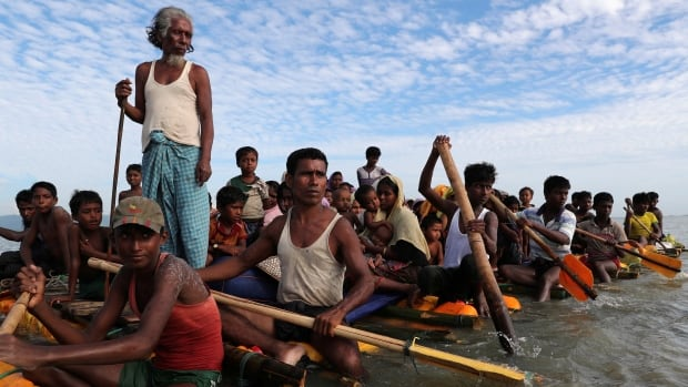 Rohingya refugees cross the Naf River with an improvised raft to reach to Bangladesh in Teknaf, Bangladesh, on Sunday.