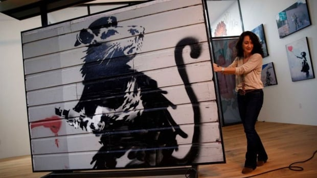 This Banksy piece will be in Windsor-Essex this week at the WolfHead Distillery.