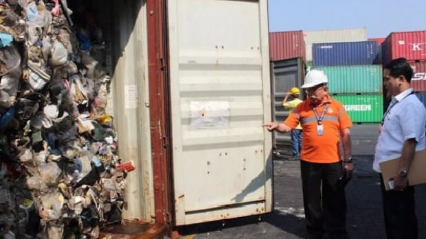 Officials check a shipping container holding Vancouver garbage in Mailia in this undated, handout photo.