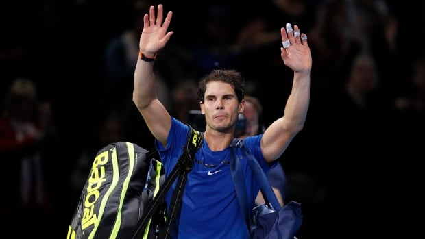 Spain's Rafael Nadal waves to supporters after losing his singles tennis match against David Goffin of Belgium at the ATP World Finals.