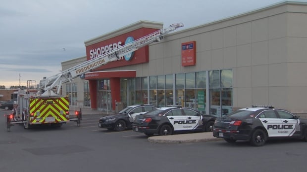 A man faces numerous charges after barricading himself in the ceiling of Fredericton drug store for three hours.