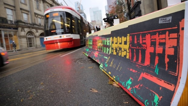 The city decorated the concrete barriers along King Street that protect streetcar riders from traffic with three distinct art pieces created by a local designer.