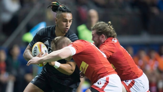 Maori All Blacks' Sean Wainui, left, is hit by Canada's Ben Lesage, front, and Dan Moor, right, during a match on Nov. 3.
