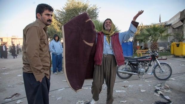 A man reacts following an earthquake in Sarpol-e Zahab county in Kermanshah, Iran.