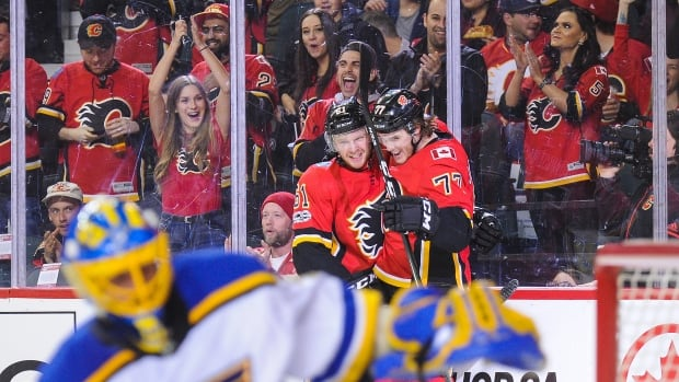 Mark Jankowski, right, scored two goals in the Calgary Flames' 7-4 win over the St. Louis Blues on Monday.