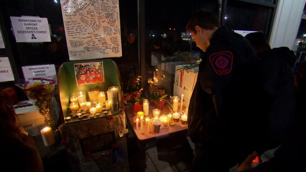 Hundreds came to the vigil to light a candle and pay their respects.