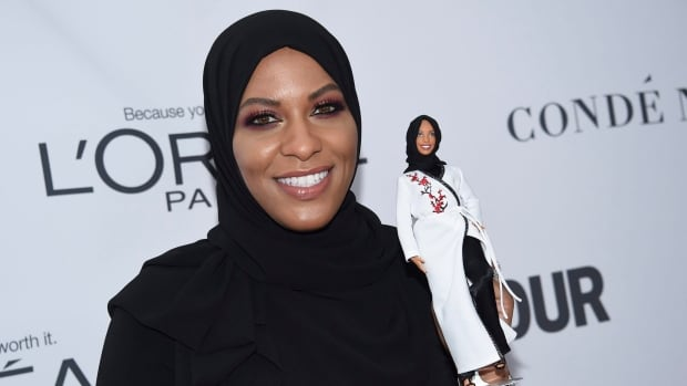 American Olympian Ibtihaj Muhammad holds a Barbie doll in her likeness at the 2017 Glamour Women of the Year Awards in New York on Monday.